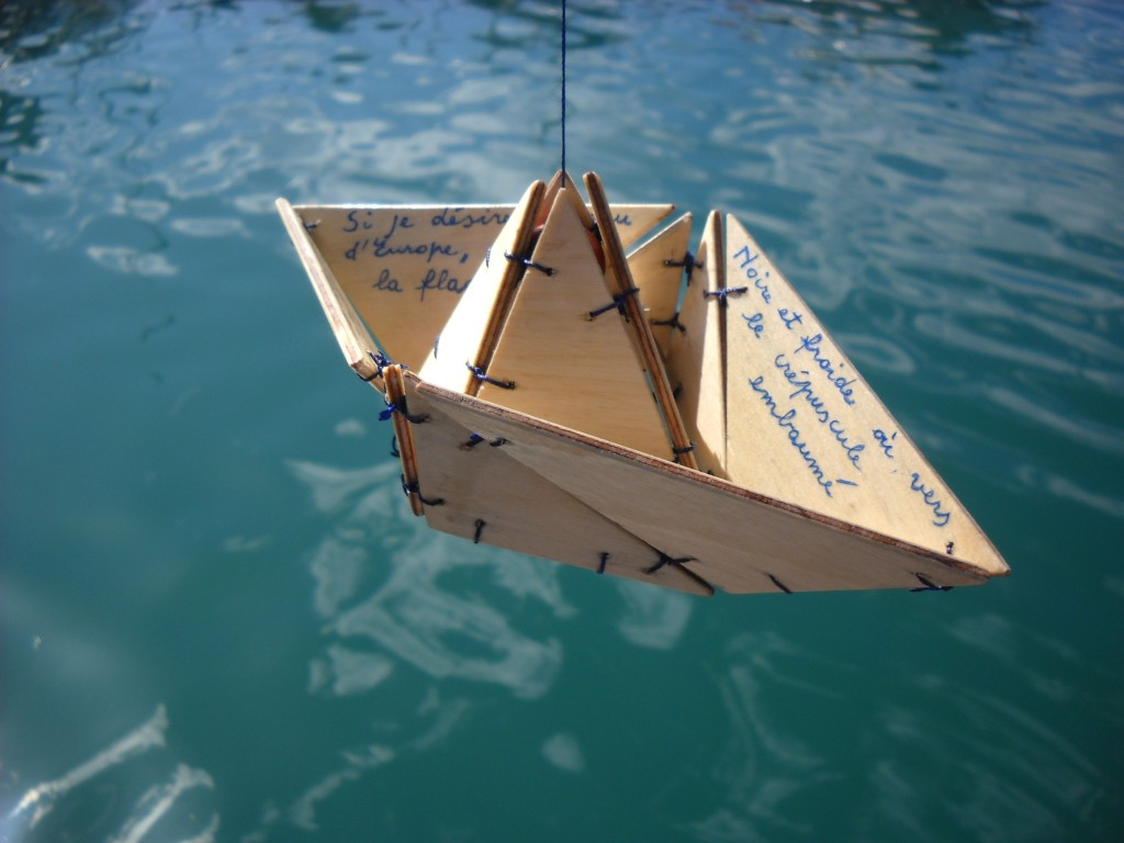 Le bateau ivre, a wood mobile composed by several pieces attached together to make a small hanging boat. Inspired by the verse-poem Le Bateau ivre